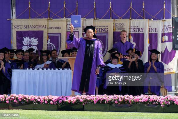 Pharrell Williams receives an honorary doctorate degree during the New York University 2017 Commencement at Yankee Stadium on May 17 2017 in the...