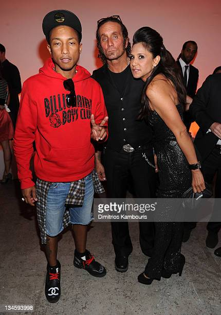 Pharrell Williams Richard Stark and Laurie Lynn Stark attend the Designer of the Year Dinner hosted by Chrome Hearts Design Miami at Art Basel at...