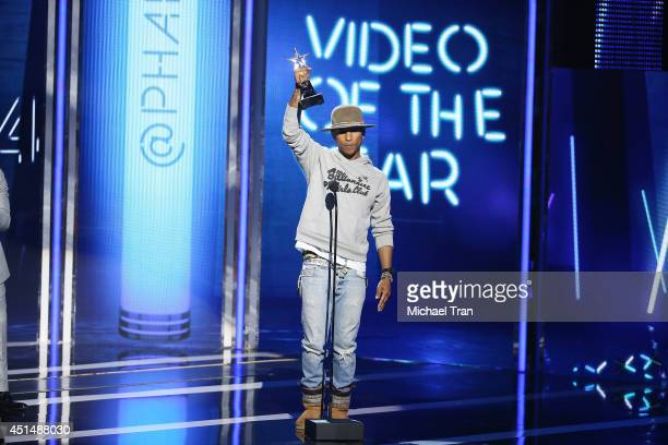 Pharrell Williams speaks onstage during the 'BET AWARDS' 14 held at Nokia Theater LA LIVE on June 29 2014 in Los Angeles California