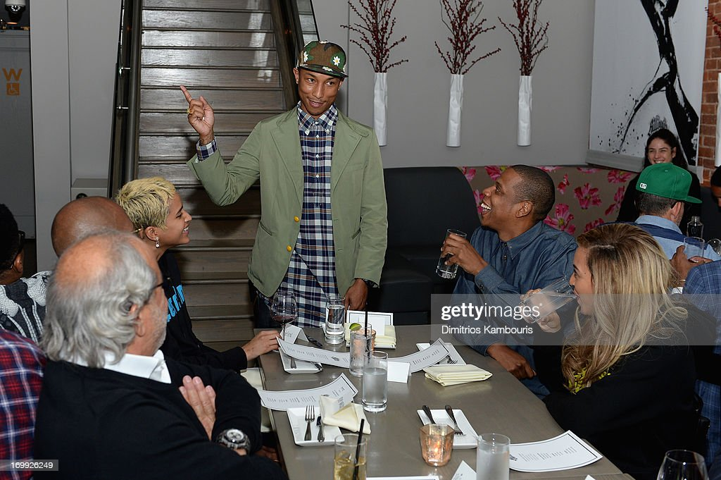 Pharrell Williams speaks to guests including Jay-Z and Beyonce at the 10th anniversary party of Billionaire Boys Club presented by HTC at Tribeca Canvas on June 4, 2013 in New York City.