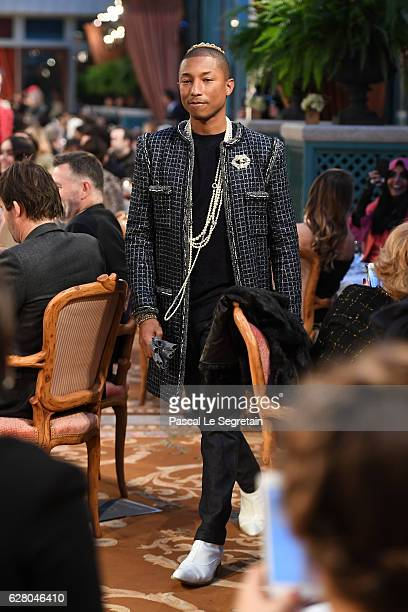 Pharrell Williams walks the runway during 'Chanel Collection des Metiers d'Art 2016/17 Paris Cosmopolite' show on December 6 2016 in Paris France