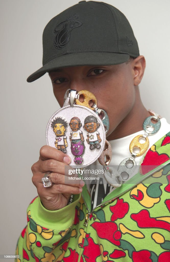<a gi-track='captionPersonalityLinkClicked' href=/galleries/search?phrase=Pharrell+Williams&family=editorial&specificpeople=161396 ng-click='$event.stopPropagation()'>Pharrell Williams</a> wearing a necklace designed by Jacob the Jeweler