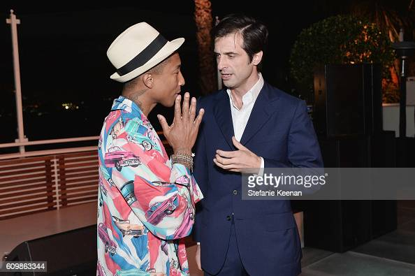 Pharrell Williams wearing Chanel and Olivier Polge attend the Chanel dinner celebrating N°5 L'Eau with LilyRose Depp at Sunset Tower Hotel on...