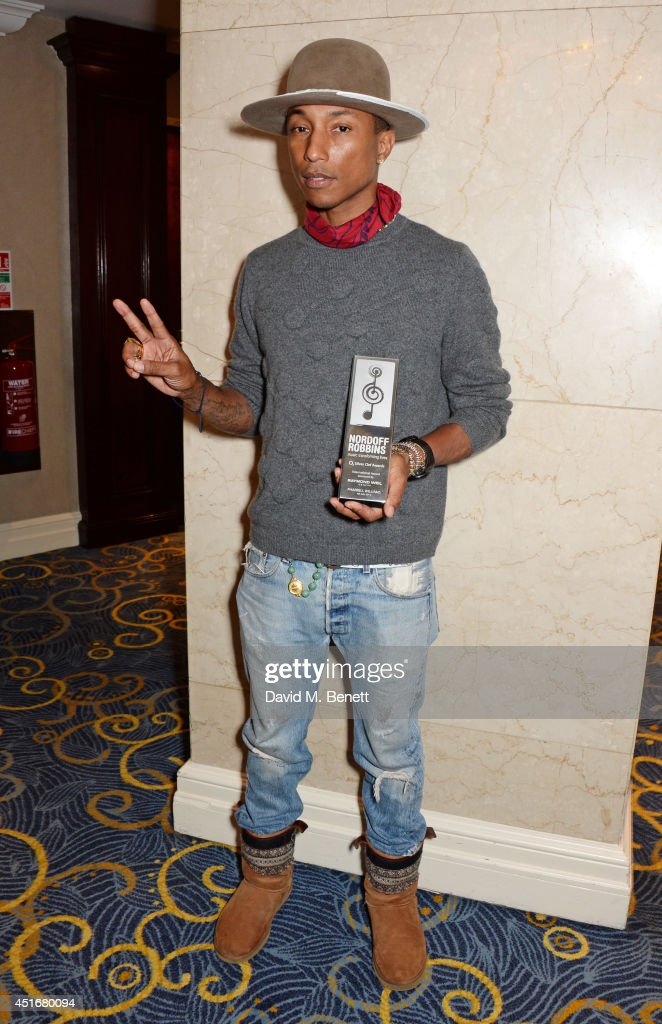 <a gi-track='captionPersonalityLinkClicked' href=/galleries/search?phrase=Pharrell+Williams&family=editorial&specificpeople=161396 ng-click='$event.stopPropagation()'>Pharrell Williams</a>, winner of the Raymond Weil International Award, attends the Nordoff Robbins 02 Silver Clef awards at the London Hilton on July 4, 2014 in London, England.