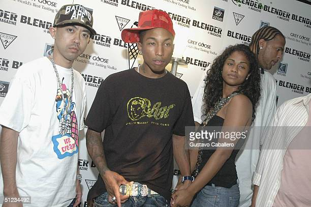 Pharrell Williams with his girlfriend and designer Nigo attends the Blender Magazine VMA PreParty on August 28 2004 at The Shore Club in Miami Beach...