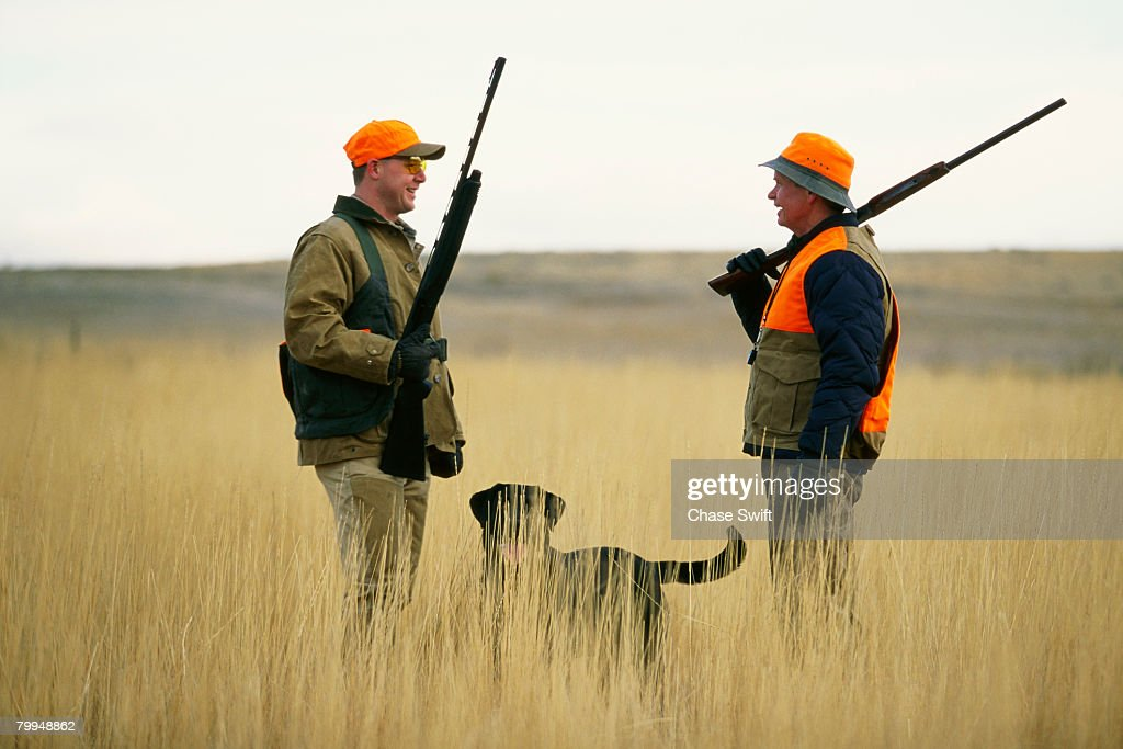 Pheasant Hunters in Field with Labrador Retriever