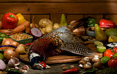 whole unprepared pheasant with ingredients