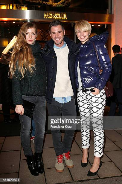 Pheline Roggan Jochen Schropp and Susan Atwell attend the Moncler Boutique Opening on December 10 2013 in Hamburg Germany