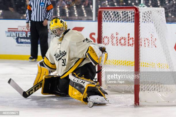 Pheonix Copley of the Michigan Tech Huskies makes a kick save against the Michigan State Spartans on December 27 2013 at Comerica Park in Detroit...