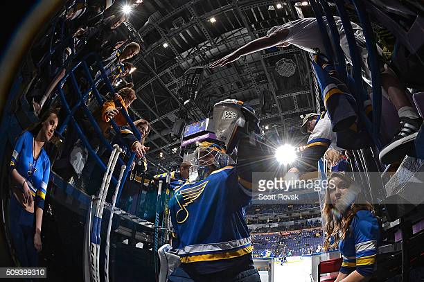 Pheonix Copley of the St Louis Blues high fives fans before a game against the San Jose Sharks at the Scottrade Center on February 4 2016 in St Louis...