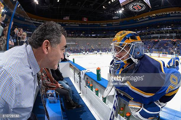 Pheonix Copley of the St Louis Blues talks to goaltending coach Jim Corsi prior to playing against the Dallas Stars at the Scottrade Center on...