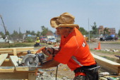 Phil Alberty with CK Construction helps to rebuild a home destroyed by the May 22 tornado July 29 2011 in Joplin Missouri The city continues with its...