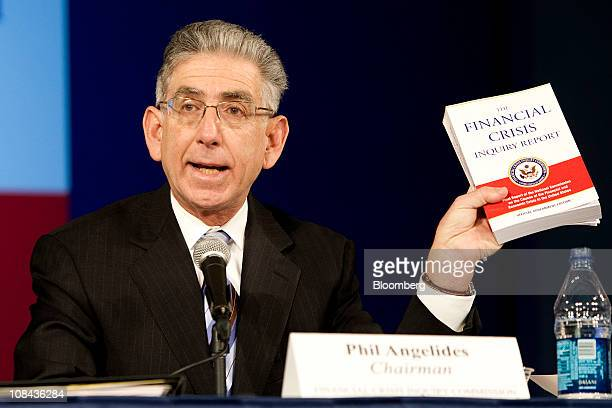 Phil Angelides chairman of the Financial Crisis Inquiry Commission displays a copy of the commission's report during its release in Washington DC US...