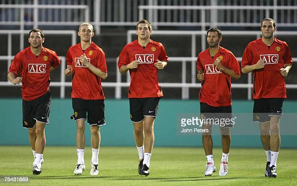 Phil Bardsley Darren Fletcher Tom Heaton Ryan Giggs and John O'Shea of Manchester United in action during a First Team training session at the start...