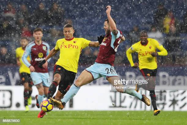 Phil Bardsley of Burnley tackles Richarlison de Andrade of Watford during the Premier League match between Burnley and Watford at Turf Moor on...