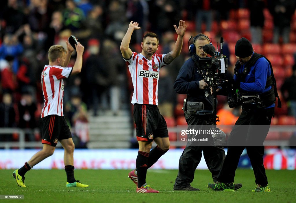 Phil Bardsley of Sunderland applauds the supporters at full-time during the Barclays Premier League match between Sunderland and Manchester City at Stadium of Light on November 10, 2013 in Sunderland, England.