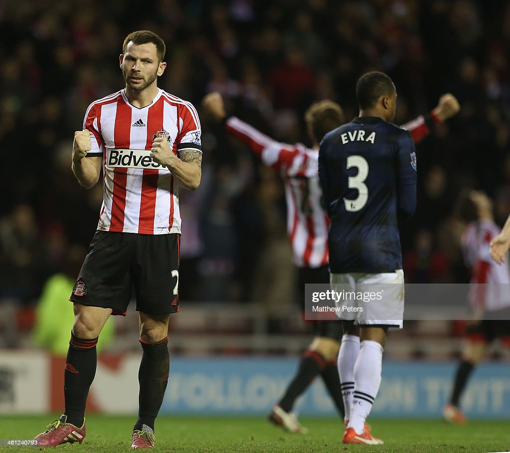 Phil Bardsley of Sunderland celebrates after the Capital One Cup Semi-Final first leg between Sunderland and Manchester United at Stadium of Light on January 7, 2014 in Sunderland, England.