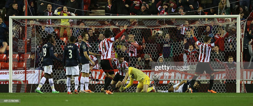 Phil Bardsley of Sunderland (C) celebrates <a gi-track='captionPersonalityLinkClicked' href=/galleries/search?phrase=Ryan+Giggs&family=editorial&specificpeople=201666 ng-click='$event.stopPropagation()'>Ryan Giggs</a> of Manchester United scoring an own-goal during the Capital One Cup Semi-Final first leg between Sunderland and Manchester United at Stadium of Light on January 7, 2014 in Sunderland, England.