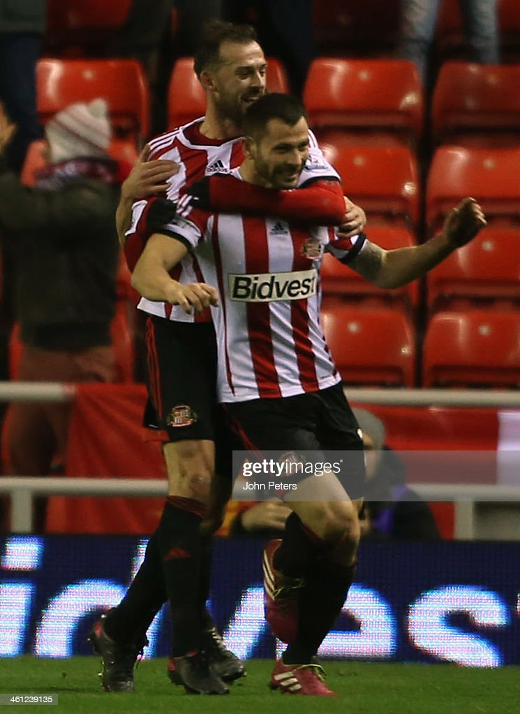 Phil Bardsley of Sunderland (R) celebrates Ryan Giggs of Manchester United scoring an own-goal during the Capital One Cup Semi-Final first leg between Sunderland and Manchester United at Stadium of Light on January 7, 2014 in Sunderland, England.