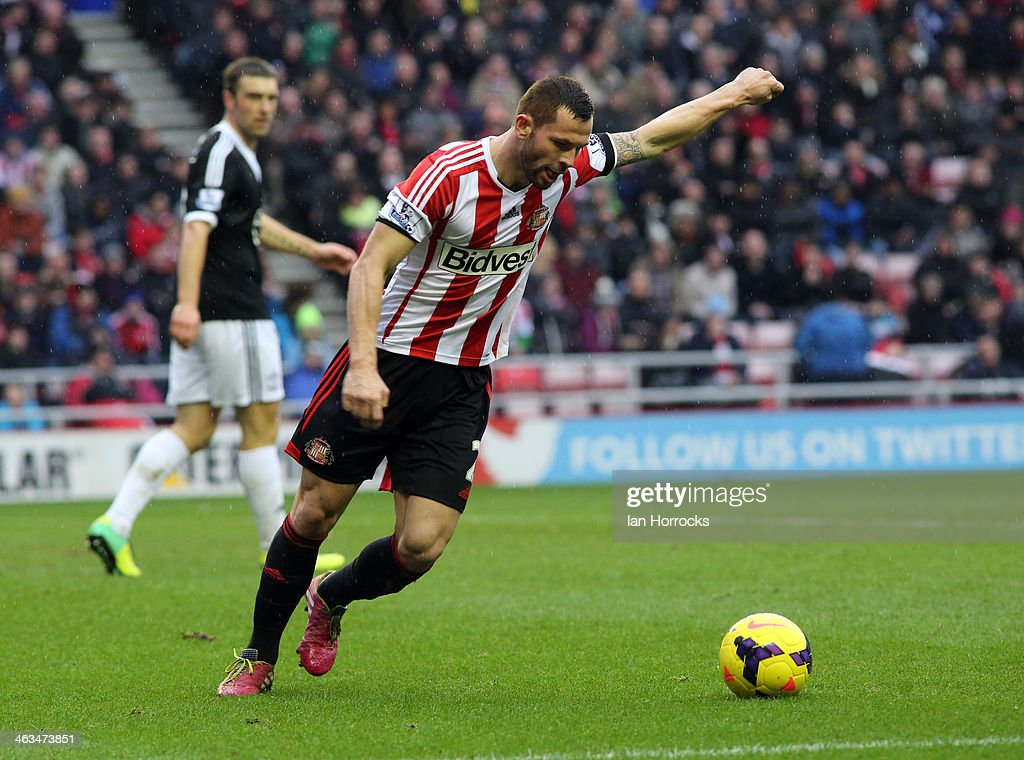 Phil Bardsley of Sunderland in action during the Barclays Premier League match between Sunderland and Southampton at the Stadium of Light on January 18, 2014 in Sunderland, England.