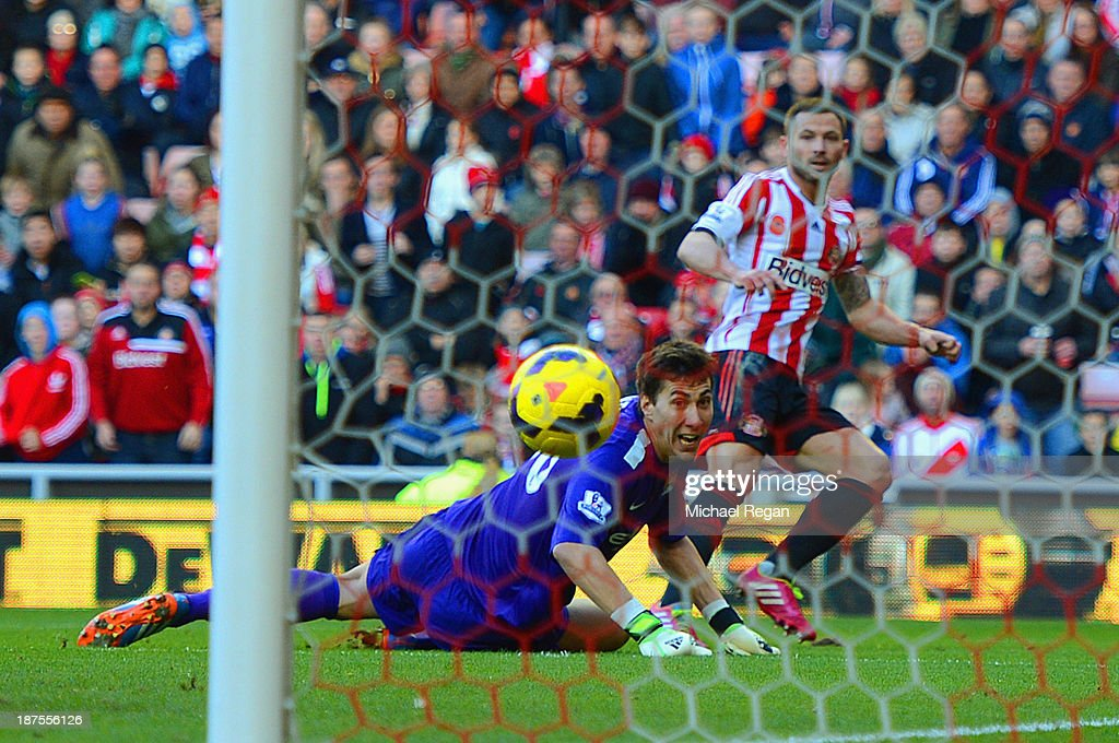 Phil Bardsley of Sunderland scores past Costel Pantilimon of Man City to make it 1-0 during the Barclays Premier league match bewtween Sunderland and Manchester City at the Stadium of Light on November 10, 2013 in Sunderland, England.