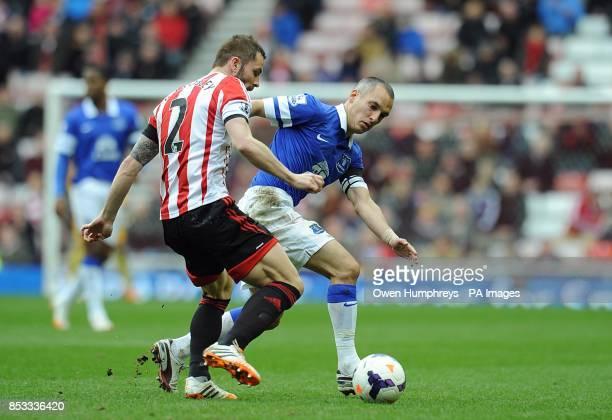Phil Bardsley Sunderland and Leon Osman Everton battle for the ball
