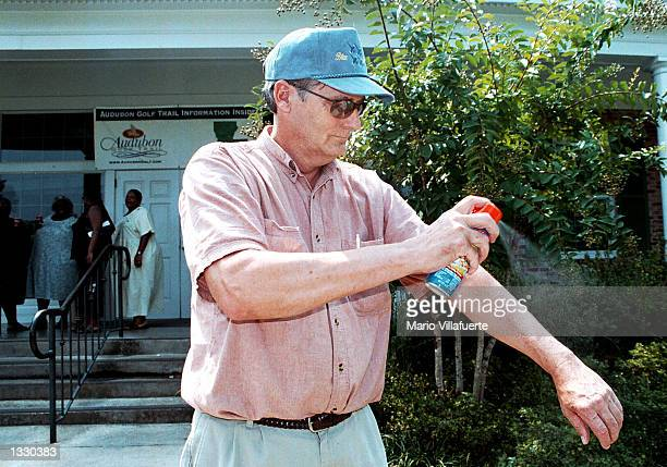 Phil Bethell sprays on mosquito repellent during a stop near the Louisiana exas border on Interstate 20 August 9 2002 at the Greenwood Louisiana...