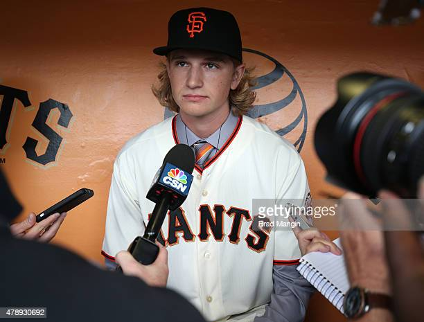 Phil Bickford the San Francisco Giants first round pick from 2015 FirstYear Player Draft talks to the media in the dugout before the game against the...