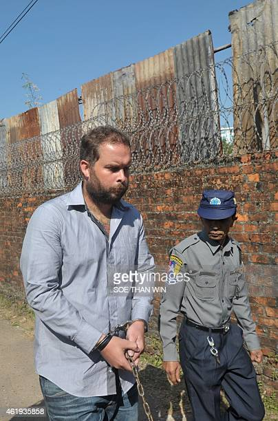 Phil Blackwood a bar manager from New Zealand is escorted by police as he arrives at a court for a hearing in Yangon on January 22 2015 Blackwood is...