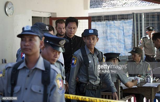 Phil Blackwood a New Zealand bar manager is guarded by police as he arrives at a court for his hearing in Yangon on December 26 2014 Blackwood is...