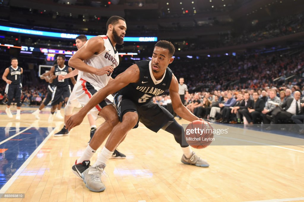 Phil Booth #5 of the Villanova Wildcats dribbles by Silas Melson #0 of the Gonzaga Bulldogs during the Jimmy V Classic college basketball game at Madison Square Garden on December 5, 2017 in New York City. The Wildcats won 88-72.
