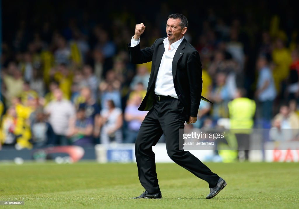 Phil Brown Manager of Southend United celebrates scoring on the pitch during the Sky Bet League 2 Play Off Semi Final second leg match between Southend United and Burton Albion at Roots Hall on May 17, 2014 in Southend, England.