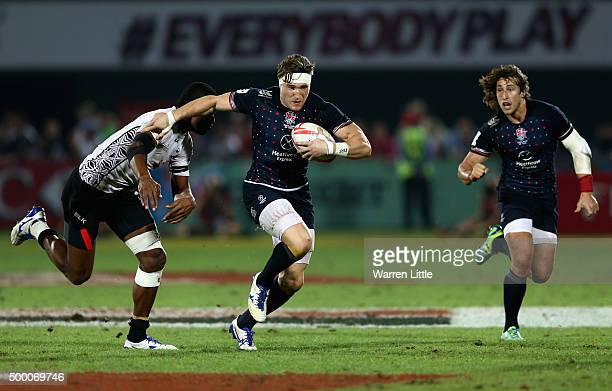 Phil Burgess of England in action against Fiji in the Cup Final during the Emirates Dubai Rugby Sevens HSBC World Rugby Sevens Series at The Sevens...
