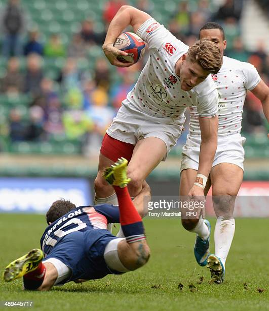 Phil Burgess of England tackled by Julien Candelon of France in the Cup Quarter Final match between England and France during The Marriott London...