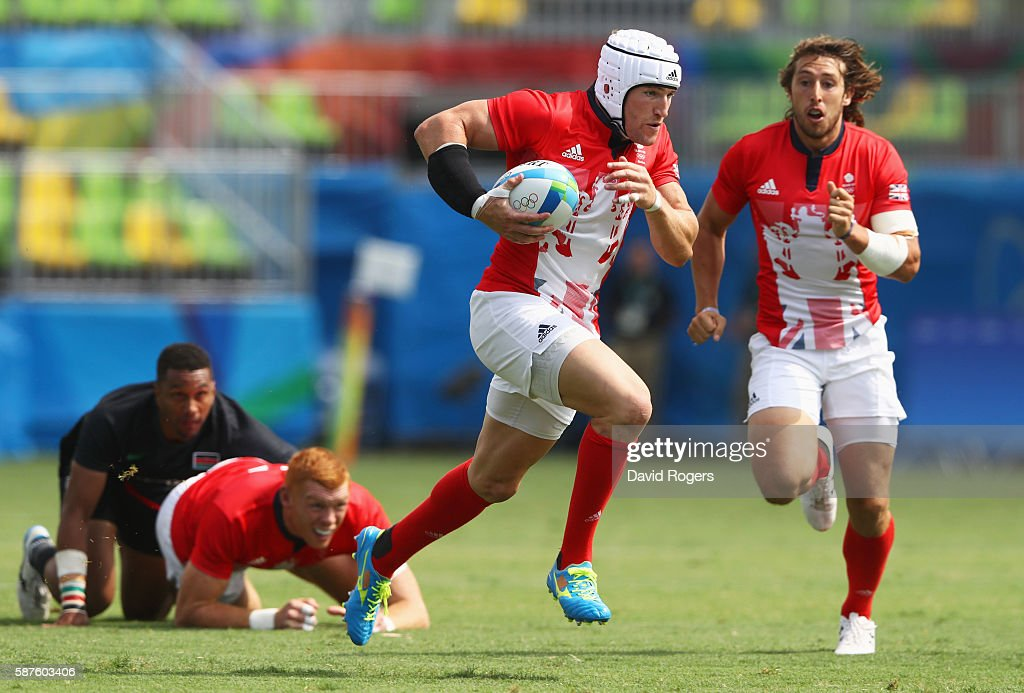 Phil Burgess of Great Britain breaks through to score a try during the Men's Rugby Sevens Pool C match between Great Britain and Kenya on Day 4 of...