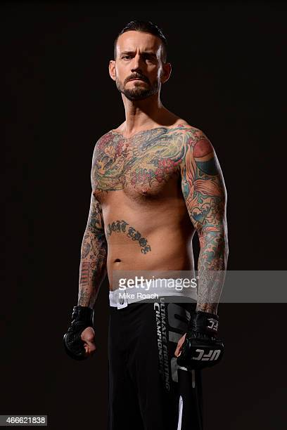 Phil 'CM Punk' Brooks poses for a photo during a UFC photo session at the Hilton Anatole Hotel on March 13 2015 in Dallas Texas