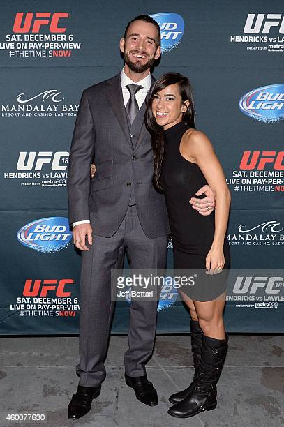 Phil 'CM Punk' Brooks poses with wife AJ Lee backstage during the UFC 181 event inside the Mandalay Bay Events Center on December 6 2014 in Las Vegas...
