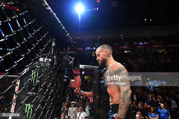 Phil 'CM Punk' Brooks prepares to enter the Octagon prior to facing Mickey Gall in their welterweight bout during the UFC 203 event at Quicken Loans...