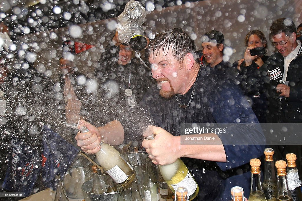 Phil Coke #40 of the Detroit Tigers celebrates in the locker room after the TIgers won 8-1 against the New York Yankees during game four of the American League Championship Series at Comerica Park on October 18, 2012 in Detroit, Michigan.