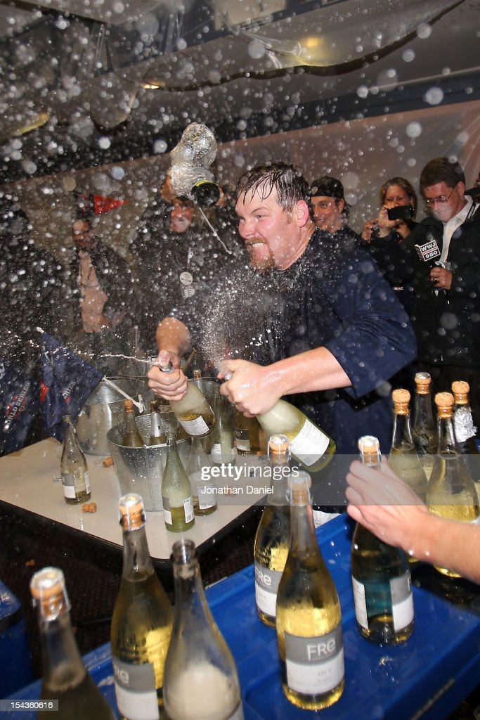 <a gi-track='captionPersonalityLinkClicked' href=/galleries/search?phrase=Phil+Coke&family=editorial&specificpeople=5518031 ng-click='$event.stopPropagation()'>Phil Coke</a> #40 of the Detroit Tigers celebrates in the locker room after the TIgers won 8-1 against the New York Yankees during game four of the American League Championship Series at Comerica Park on October 18, 2012 in Detroit, Michigan.