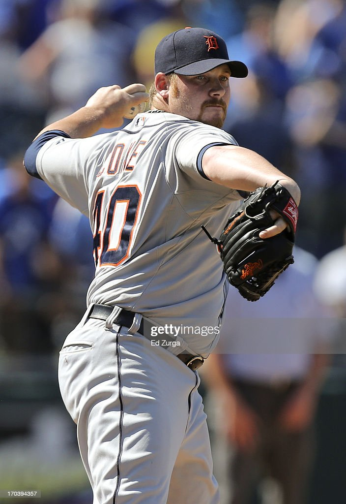 <a gi-track='captionPersonalityLinkClicked' href=/galleries/search?phrase=Phil+Coke&family=editorial&specificpeople=5518031 ng-click='$event.stopPropagation()'>Phil Coke</a> #40 of the Detroit Tigers throws to first on a pick off attempt on David Lough of the Kansas City Royals in the ninth inning during a game at Kauffman Stadium on June 12, 2013 in Kansas City, Missouri. Lough advanced to second on a fielding error on Miguel Cabrera of the Detroit Tigers.