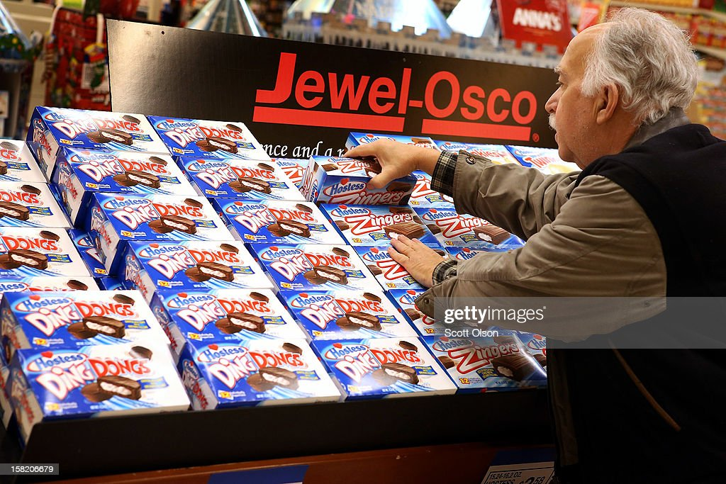Phil Colin buys Hostess snacks at a Jewel-Osco grocery store on December 11, 2012 in Chicago, Illinois. The Jewel-Osco grocery store chain purchased the last shipment of 20,000 boxes of Hostess products and put them on sale in their stores throughout the Chicago area today. Hostess Brands Inc. shut down its baking operations and began liquidating assets last month after failing to negotiate a labor contract with Workers with the Bakery, Confectionery, Tobacco Workers and Grain Millers International Union