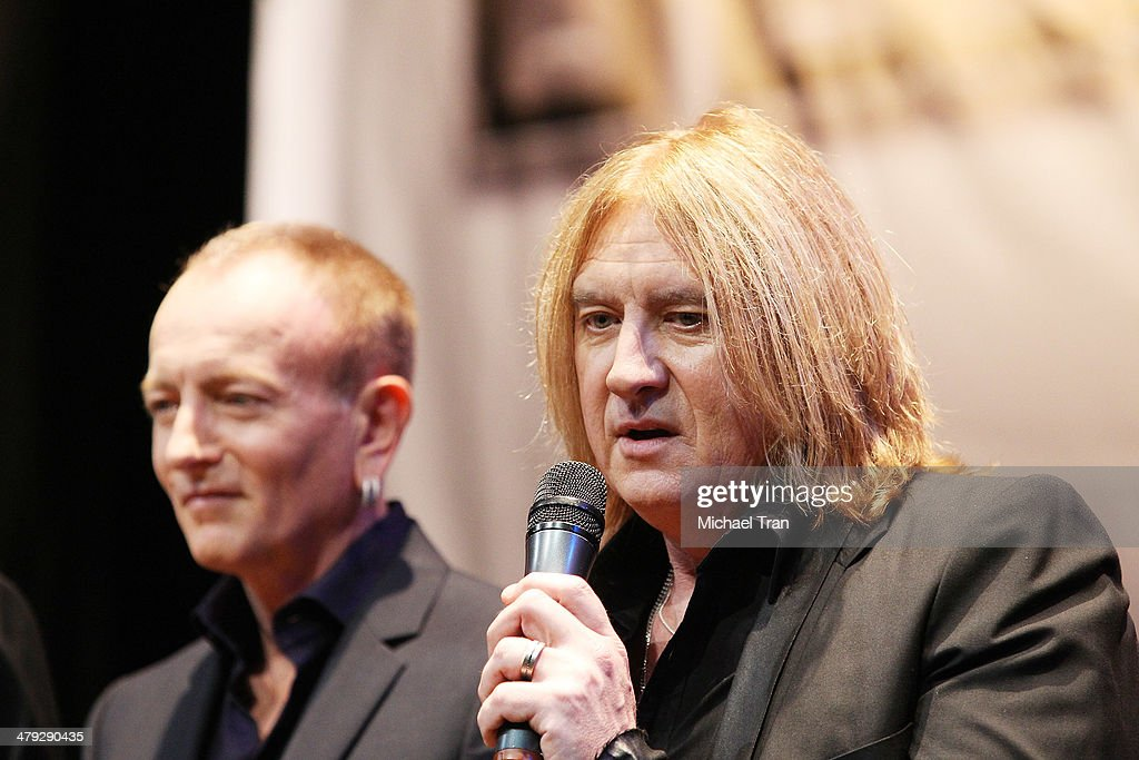 Phil Collen and Joe Elliott (R) of Def Leppard speak onstage during the KISS and Def Leppard announcment of their 2014 Summer tour held at The House of Blues on Sunset on March 17, 2014 in Los Angeles, California.