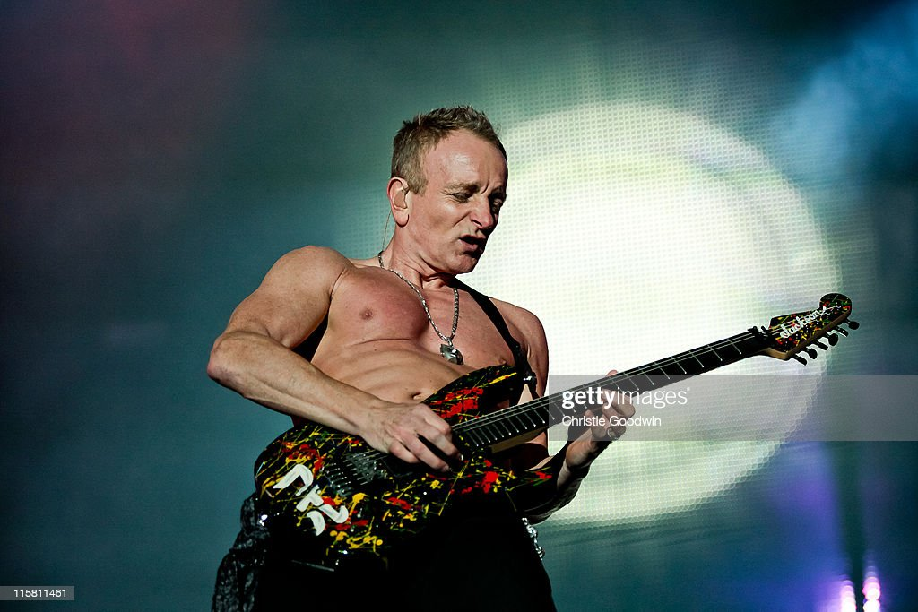 Phil Collen of Def Leppard performs on stage as headliner on Day 1 of Download Festival at Donington Park on June 10, 2011 in Castle Donington, England.