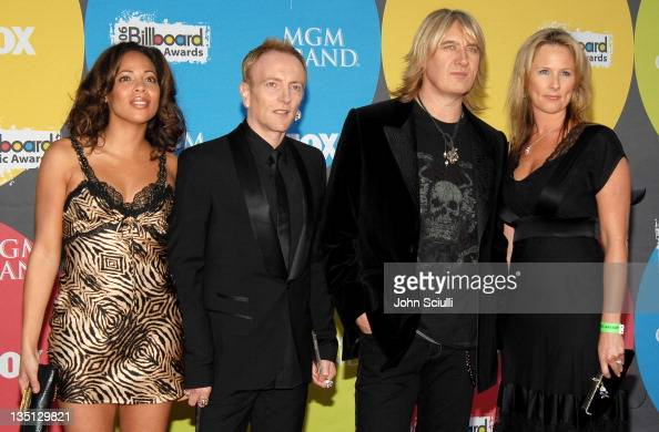 ... with wife Anita and Joe Elliott of Def Leppard with wife Kristine
