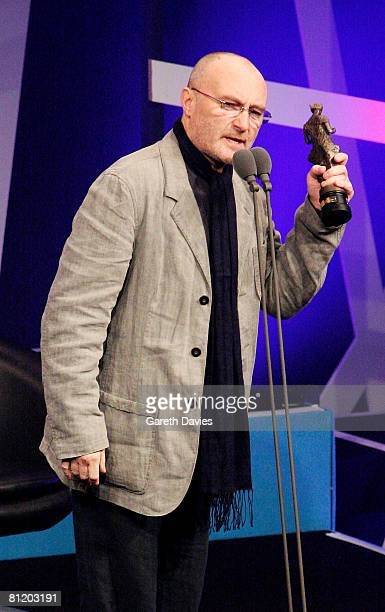 Phil Collins accepts the award for International Achievement on stage at the 53rd Ivor Novello Awards at the Grosvenor House Hotel on May 22 2008 in...