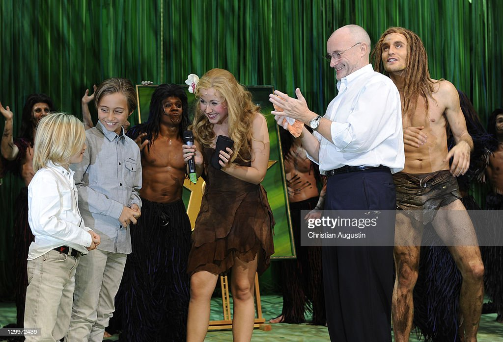 Phil Collins and both sons Matthew Collins and Nicholas Collins, Alexander Klaws (Tarzan) and Elisabeth Huebert (Jane) attend Tarzan Musical 3rd anniversary at Theatre 'Neue Flora' on October 22, 2011 in Hamburg, Germany.