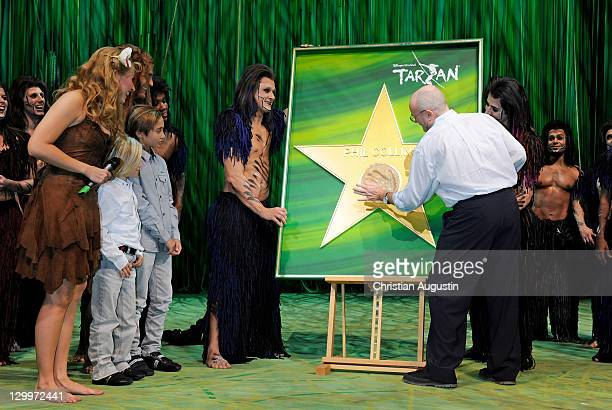 Phil Collins and both sons Matthew Collins and Nicholas Collins Elisabeth Huebert and Alexander Klaws are watching a handprint honouring Phil Collins...