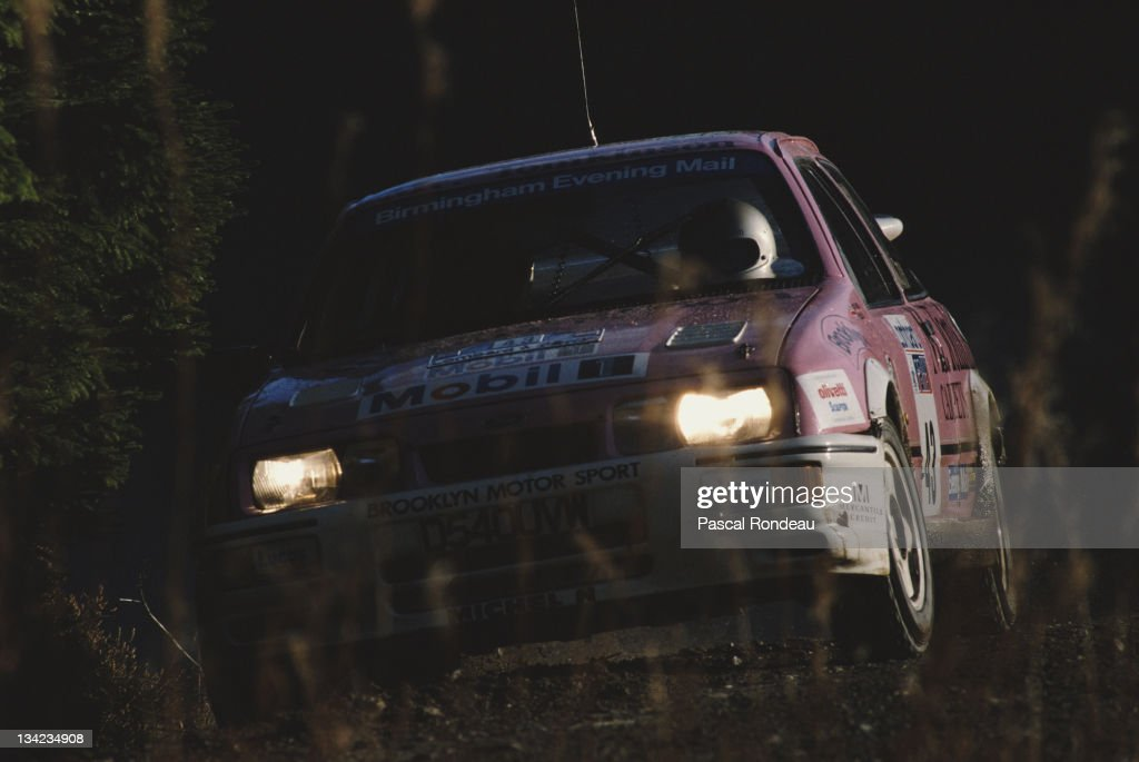 Phil Collins and co driver Bryan Thomas of Great Britain driving the Brooklyn Motorsport Ford Sierra RS Cosworth during the FIA World Rally...