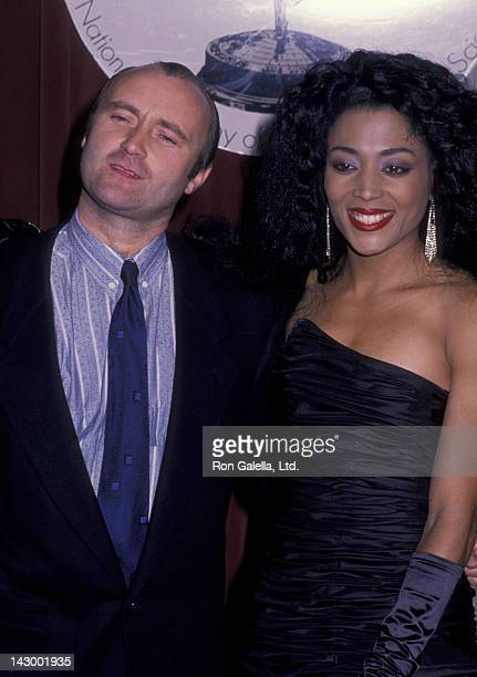 Phil Collins and Florence Joyner attend 16th Annual International Emmy Awards on November 21 1988 at the Sheraton Hotel in New York City